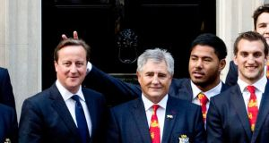 "British and Irish Lions rugby star Manu Tuilagi sticking his fingers above Prime Minister David Cameron's head to give him ""bunny ears"" during a photo shoot at Downing Street to honour the Lions' victory over Australia. Photograph:  Chris Harris/The Times/PA Wire"