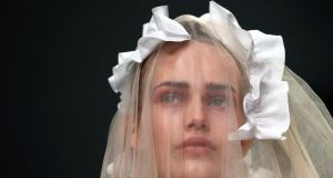 A model presents a creation from the Simone Rocha Spring/Summer 2014 collection during London Fashion Week yesterday.