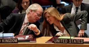 British ambassador Mark Lyall Grant and US ambassador Samantha Power confer in the United Nations Security Council yesterday. Photograph: AP Photo/Richard Drew