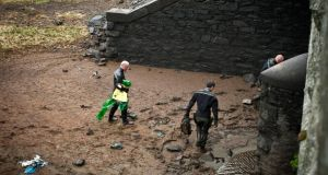 Members of the Garda water unit recover items including a rucksack from the reservoir near Roundwood, Co Wicklow. Photograph: Garry O'Neill