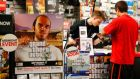 "Game enthusiasts purchase the latest release of ""Grand Theft Auto Five"" after the game went on sale at the Game Stop store in Encinitas, California yesterday. REUTERS/Mike Blake"