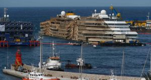 "The capsized cruise liner Costa Concordia is seen at the end of the ""parbuckling"" operation outside Giglio harbour."