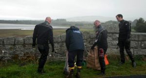 Members of the Garda water unit recover items including a rucksack from the reservoir near Roundwood, Co Wicklow, as the continue their investigations into missing woman Elaine O'Hara. Picture: Garry O'Neill