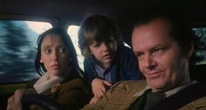 Famous faces: Jack Nicholson, Shelley Duvall and Danny Lloyd en route to the Overlook Hotel in the film version of Stephen King's The Shining