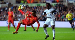 Phillipe Coutinho attempts an overhead kick against Swansea. Photograph: Stu Forster/Getty Images