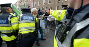 Gardaí clash with protestors after protestors tried to gain access to the Dáil. Photograph: Alan Betson / THE IRISH TIMES