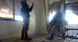 "UN chemical weapons experts wearing gas masks inspect one of the sites of an alleged chemical weapons attack in the Damascus' suburb of Zamalka – ""the  US has estimated that Syria possesses approximately 1,000 metric tons of chemical agent such as the neurotoxin Sarin and other variants including VX gas."" PHOTOGRAPH:  REUTERS/MOHAMMAD ABDULLAH"