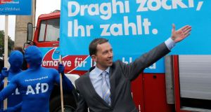 "Bernd Lucke, the leader of the euro-critical Alternative for Germany party (AfD) in front of a campaign poster during an election campaign rally in Berlin. The placard reads ""Draghi gambles, you pay"". Photograph: Reuters"