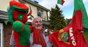 Mayo supporter John Dunne outside his home yeaterday at Hawthorn Place in Knocknacarra, Galway. Photograph: Joe O'Shaughnessy