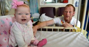 Ellie Ward in Temple Street hospital, Dublin with her dad, John Ward. Photographs: Dara Mac Dónaill
