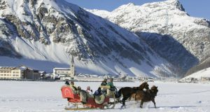 Tourists on a sleigh ride, Livigno, Italy. Photograph: Getty Images/Jan Greune