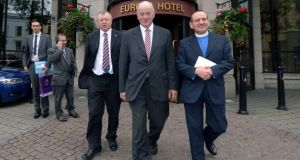 Orange Order Grand Secretary Drew Nelson and Grand Master Robert Stevenson   leave the Europa Hotel with the Reverend Alastair Smyth  after conducting talks with Richard Haas. Photograph: Pacemaker