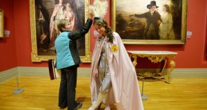 Claudia Seaver from Alaska chats with Karen Greene dressed as 'The Earl of Bellamont' from a painting by Joshua Reynolds  as 'Paintings Come to Life' in advance of Culture Night tonight at the National Gallery of Ireland. The Gallery will be one of many cultural institutions which will provide free access and remain open till 9:30pm  Photograph: Alan Betson/The Irish Times