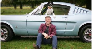 Writer John Connolly, his dog and his Ford Mustang. Photograph: Bryan O'Brien