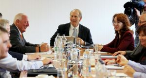 US diplomat Richard Haass (centre) assisted by Harvard professor Meghan O'Sullivan (right) during round table Photograph: Paul Faith/PA Wire