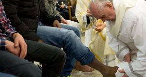 "Pope Francis washing the foot of a prisoner at a youth prison in Rome in March –   ""with his utterly refreshing candour and openness, and his blunt description of himself as a 'sinner', he is allowing people to see Catholicism in a new light."" PHOTOGRAPH:  REUTERS/OSSERVATORE ROMANO"