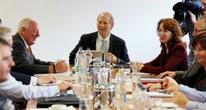"US diplomat Richard Haass (centre) assisted by Harvard professor Meghan O'Sullivan (right) during round table talks at the Europa Hotel in Belfast – ""Haass's agenda shows how difficult issues were parked to get the executive running and how limited reconciliation has been at base level."" PHOTOGRAPH: PAUL FAITH/PA WIRE"