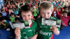 Tom Donnellan and Shane Flanagan-Trias who won a ticket each to the All-Ireland final during a school draw at Scoil Íosa, Ballyhaunis, Co Mayo, yesterday.  Photograph: James Crombie/INPHO