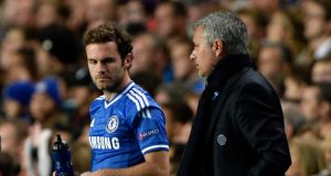 Chelsea's manager Jose Mourinho has warned Juan Mata he will remain on the periphery of the Chelsea first team until he adapts his game to fit the new manager's style.
