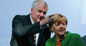 German chancellor Angela Merkel and Bavarian state premier Horst Seehofer. Two opinion polls today showed Ms Merkel's conservatives and their Free Democrat (FDP) coalition partners in a dead heat with the combined leftist opposition on 45 per cent each. Photograph: Michael Dalder/Reuters
