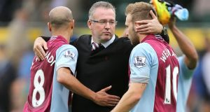 Aston Villa manager Paul Lambert (centre) celebrates after the final whistle with Karim El Ahmadi (left) and Andreas Weimann  at Carrow Road. Photograph: Chris Radburn/PA Wire