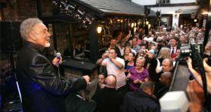 "Tom Jones singing to a crowd in the Brazen Head pub on Arthur's Day 2009 – ""a clever way to enhance the Guinness brand"". Photograph: Dara Mac Dónaill"