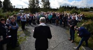 Family, relatives, friends and locals attending a ceremony organised by the Wave Trauma Centre, where the Bishop of Meath, Dr Michael Smith, led prayers for the Disappeared of the Northern Troubles, at a bog in Oristown, Co Meath, where it is thought some bodies of the Disappeared are buried. Photograph: Dara Mac Dónaill