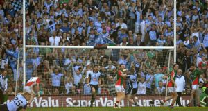 Bernard Brogan celebrates his second goal against Mayo. Photograph: Dara MacDonaill