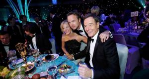 Actors Anna Gunn, Aaron Paul and Bryan Cranston celebrate the success of Breaking Bad at the Governors Ball for the 65th Primetime Emmy Awards in Los Angeles yesterday. Photograph: Reuters