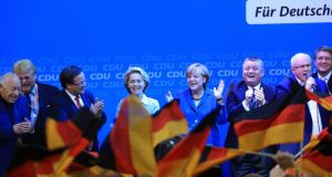 Angela Merkel, Germany's chancellor and party leader of the Christian Democratic Union (CDU), center, stands with supporters on stage during victory celebrations after the German federal elections results were announced in Berlin, yesterday. Recent data shows that the German economy is likely to grow by about 0.4 per cent in the third quarter. Photographer: Krisztian Bocsi/Bloomberg