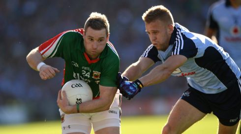 Dublin's Jonny Cooper tackles Mayo's Michael Conroy. Photograph: Dara Mac Dónaill/The Irish Times