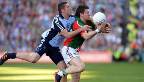 Dublin's Darren Daly puts pressure on Mayo's Enda Varley.  Photograph: Eric Luke/The Irish Times