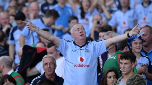 Conducting an ecstasy symphony: Dublin fan celebrates beating Mayo. Photograph: Dara Mac Dónaill/The Irish Times