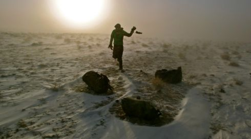 McCarron dances to keep warm in a Gobi Desert blizzard. Photograph: Leon McCarron/PA Wire