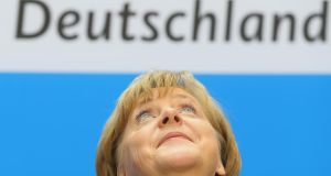 German Chancellor and Christian Democratic Union leader Angela Merkel looks on during a press conference after a meeting of the CDU governing board on the first day after German federal elections at CDU headquarter  today. Photograph: Getty