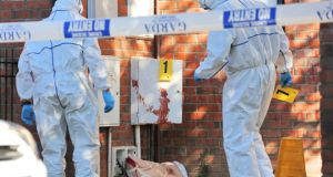 Crime scene investigators at the scene of the fatal stabbing in Tallaght last night. Photograph: Colin Keegan, Collins