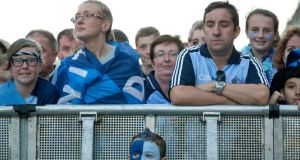 Conall Gleeson from Blanchardstown gets a good seat to watch the Dublin team. Photograph: Morgan Treacy/Inpho