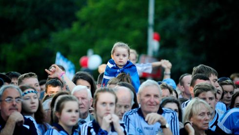 A young girl pictured waiting for the arrival of the Dublin Football team in Merrion Square Dublin. Photograph: Aidan Crawley/The Irish Times
