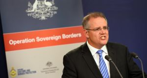 Australian Minister for Immigration and Border Protection Scott Morrison speaks on the new federal government's Operation Sovereign Borders policy during a press conference in Sydney on Monday. Photograph: Getty