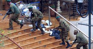 Kenya Defence Forces soldiers take their position in the Westgate shopping centre in Nairobi today. Photograph: Reuters