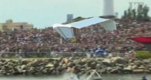 "Videograb of the  Chicken Whisperers' ""chicken"" flying at Long Beach, California, shattering a previous Flugtag world record set in Germany in 2012 by 29 feet."