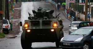 A Kenya Defence Forces (KDF) armoured military vehicle drives to the Westgate shopping centre after an exchange of gunfire inside the mall today. Photograph: Thomas Mukoya /Reuters