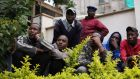 Residents look at the military rescue operation at the Westgate shopping centre in Nairobi. Photograph: Karel Prinsloo/Reuters