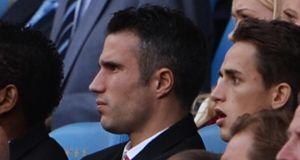 Robin van Persie of Manchester United in the stands prior the defeat to Manchester City. The Dutchman will miss the League Cup game against Liverpool this week as well. Photograph: Michael Regan/Getty Images