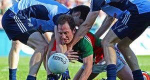 Mayo's Alan Dillon loses possession under pressure from the Dublin defence