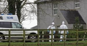 Gardai at the farm outside Bagnalstown, Co Carlow last year. Photograph: Eric Luke /The Irish Times