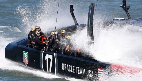 Oracle Team USA in receipt of some dampness. Photograph: Stephen Lam/Reuters