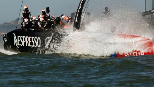 That's Emirates Team New Zealand somewhere amid the wall of water. Photograph: Robert Galbraith/Reuters