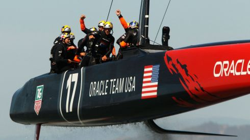 Crew members of Oracle Team USA looking happy after defeating Emirates Team New Zealand in Race 18.  Photograph: Robert Galbraith/Reuters
