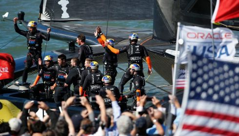 Team USA acknowledge race fans after winning Race 18. Photograph: Stephen Lam/Reuters
